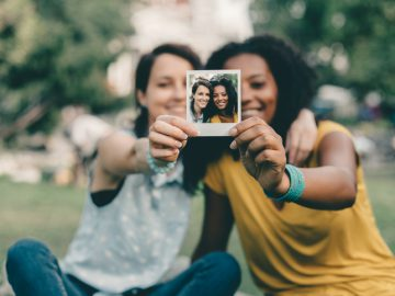 Girls showing instant photo selfie together